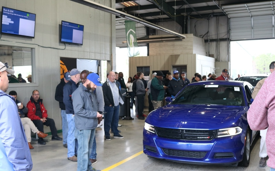 Wholesale car dealers bidding on a vehicle at Greenville Auto Auction