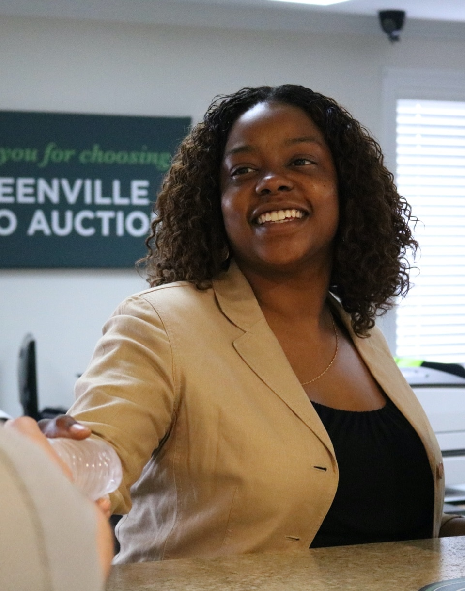 A happy employee of Greenville Auto Auction. We're here to serve you!
