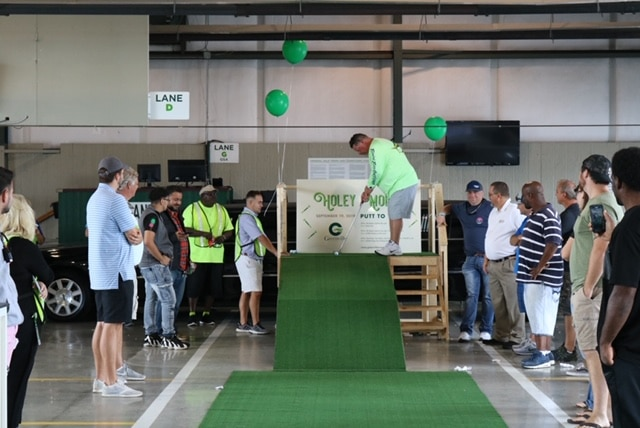 Wholesale car dealers enjoying a game of putt-putt at Greenville Auto Auction in NC