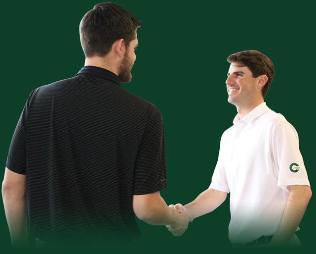 Greenville Auto Auction employee shaking hands with a happy wholesale car dealer customer